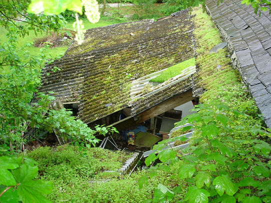 The dilapidated lean-to roof at Upperdale House, Monsal Dale, prior to repairs beginning