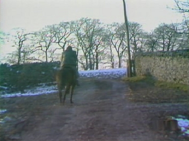 Charles flees on horseback as the riders close in