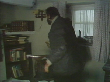 Charles searches the shelves for Fenton's notes